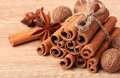 Cinnamon sticks, nutmeg and anise on wooden table — Stock Photo