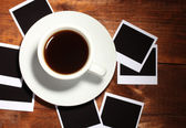 Photo papers with coffee on wooden background — Stock Photo