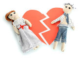 Two voodoo dolls boy and girl on the broken heart isolated on white — Stock Photo