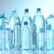 Stock Photo: Group plastic bottles of water on blue background