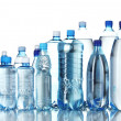 Group plastic bottles of water isolated on white — Stock Photo