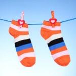 Bright striped socks on line on blue background — Stock Photo #8537862