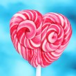 Delicious candy on stick on blue background — Stock Photo #8537924