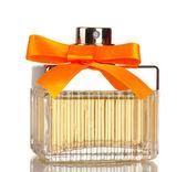 Perfume bottle with orange bow isolated on white — Stock Photo