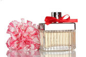 Perfume bottle with red bow and carnation isolated on white — Stock Photo