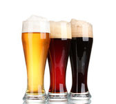 Three glasses with different beers isolated on white — Stock Photo
