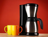 Coffee maker on red background — Stock Photo