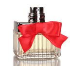 Perfume bottle with red bow isolated on white — Stock Photo