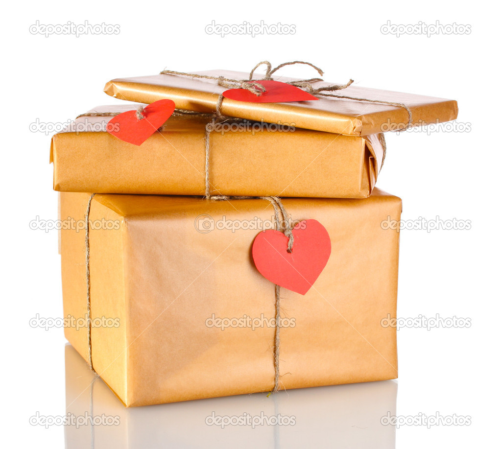 Three parcels with blank heart-shaped labels isolated on white — Stock Photo #8585378