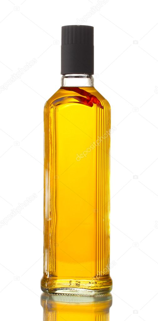 Bottle of vodka with pepper isolated on white  Stock Photo #8588862