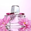 Womans perfume in beautiful bottle and flowers isolated on white — Stock Photo