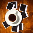 Photo papers with coffee on wooden background — Stock Photo #8592768