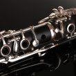 Close up detail of clarinet on black background — Stock Photo #8617504