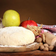 ingredients for homemade pie on wooden table on brown background — Stock Photo