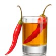 Glass of pepper vodka and red chili peppers isolated on white — Stock Photo #8617575