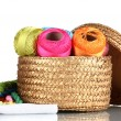 Bright threads for needlework and fabric in a wicker basket - Stock Photo