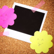 Photo paper with colored paper in the shape of a flower on сork background - Stock Photo