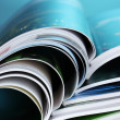 Magazine on blue background — Stock Photo