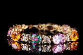 Beautiful bracelet with precious stones on black background — Stock Photo