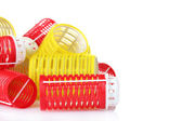 Red and yellow curlers isolated on white — Stock Photo