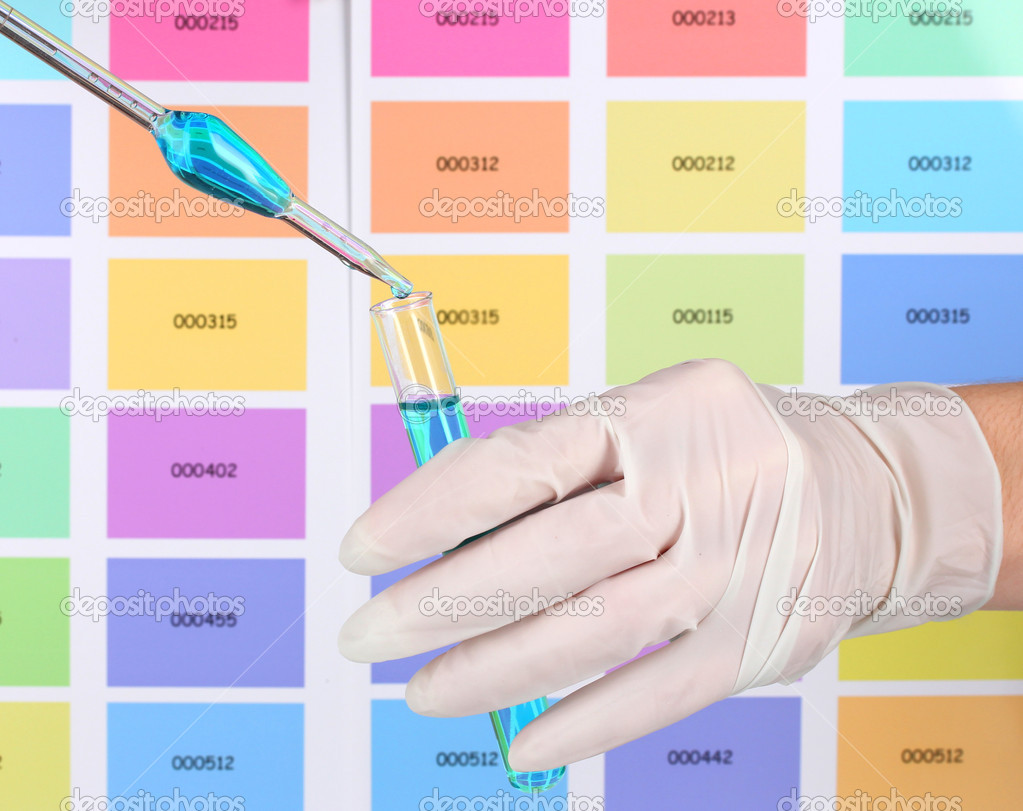 Test-tube with blue liquid and pipette in scientist's hands on color samples background — Stock Photo #8617701