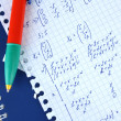 Math on copybook page closeup — Stock Photo #8644886