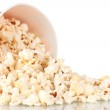 Full bucket of popcorn dropped isolated on white — Stock Photo #8650692