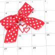 Calendar page with hearts and bow on St.Valentines Day - Foto Stock