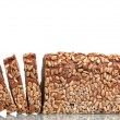 Delicious sliced rye bread with sunflower seeds isolated on white - Stock Photo