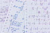 Math, physics and geometry on copybook page closeup — Stock Photo