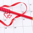 Calendar page with hearts, pencil and ribbon on St.Valentines Day - Lizenzfreies Foto