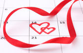 Calendar page with hearts and ribbon on St.Valentines Day — Stock Photo