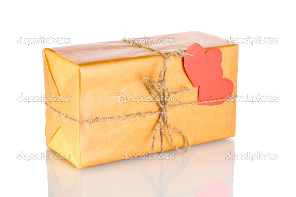 Parcel with blank heart-shaped label isolated on white  Stockfoto #8699356