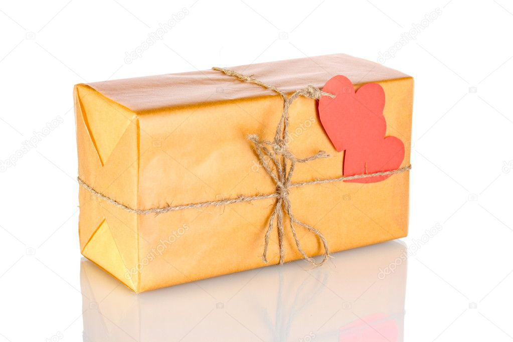 Parcel with blank heart-shaped label isolated on white — Stockfoto #8699356