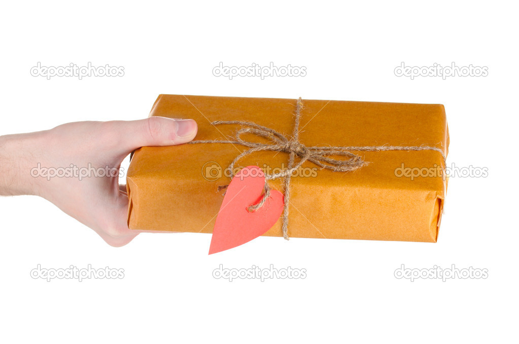Parcel with blank heart-shaped label in man's hand isolated on white — Stock Photo #8699376
