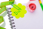 Planning of diet. Notebook measuring tapes and pen isolated on white — Stock Photo