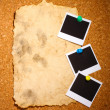 Photo paper with old paper on сork background — Stockfoto