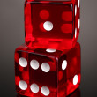 Red dices on grey background — Stock Photo #8731807