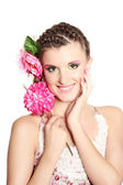 Beautiful girl with flowers in her hair isolated on white — Stock Photo