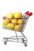 Rijp citroenen in uw winkelwagen geïsoleerd op wit — Stockfoto