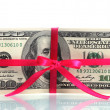 A lot of one hundred dollar bills tied pink ribbon isolated on white — Stock Photo