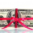 A lot of one hundred dollar bills tied pink ribbon isolated on white — Stock Photo #8749330