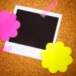 Photo paper with colored paper in the shape of a flower on сork background — Foto de Stock