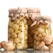 Delicious marinated mushrooms in the glass jars and raw champignons isolate — 图库照片 #8749388