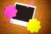 Photo paper with colored paper in the shape of a flower on сork background — Stock Photo