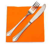 Fork and knife in a orange cloth isolated on white — Stock Photo