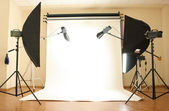 Empty photo studio with lighting equipment — Stock Photo