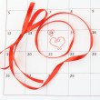 Stock Photo: Calendar page with hearts and ribbon on St.Valentines Day