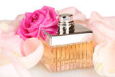 Perfume in a beautiful bottle, petals and pink rose isolated on white — Stock Photo