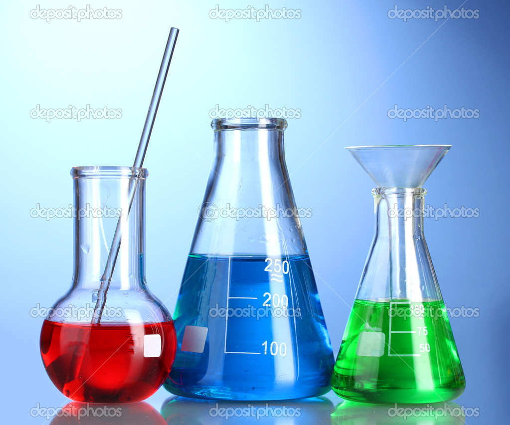 Three flasks with color liquid with reflection on blue background — Stock Photo #8766265